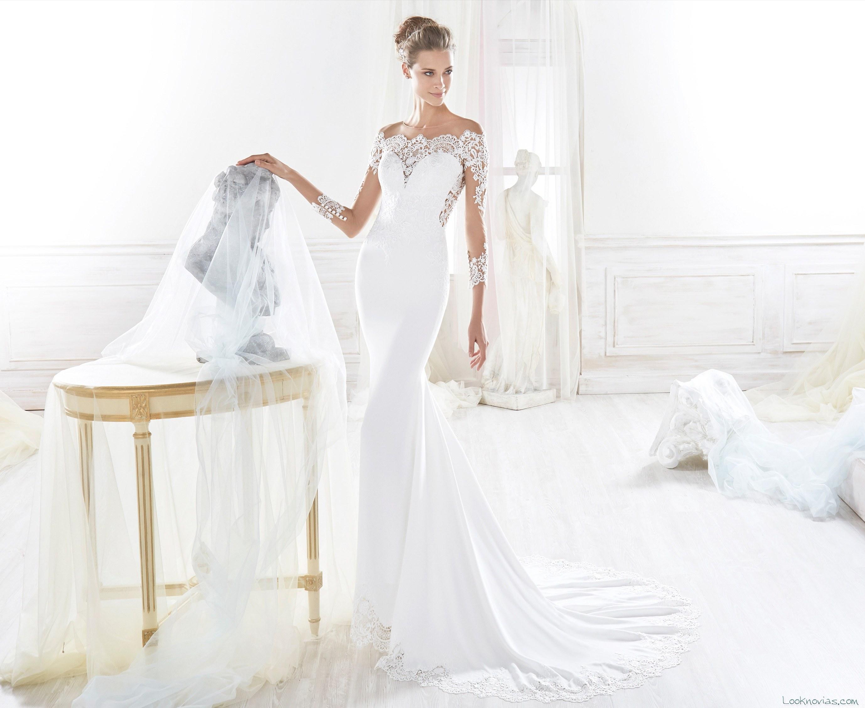 vestido blanco recto y escote con encaje