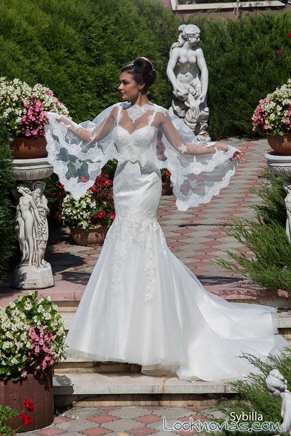 vestido de novia con capa de bordados
